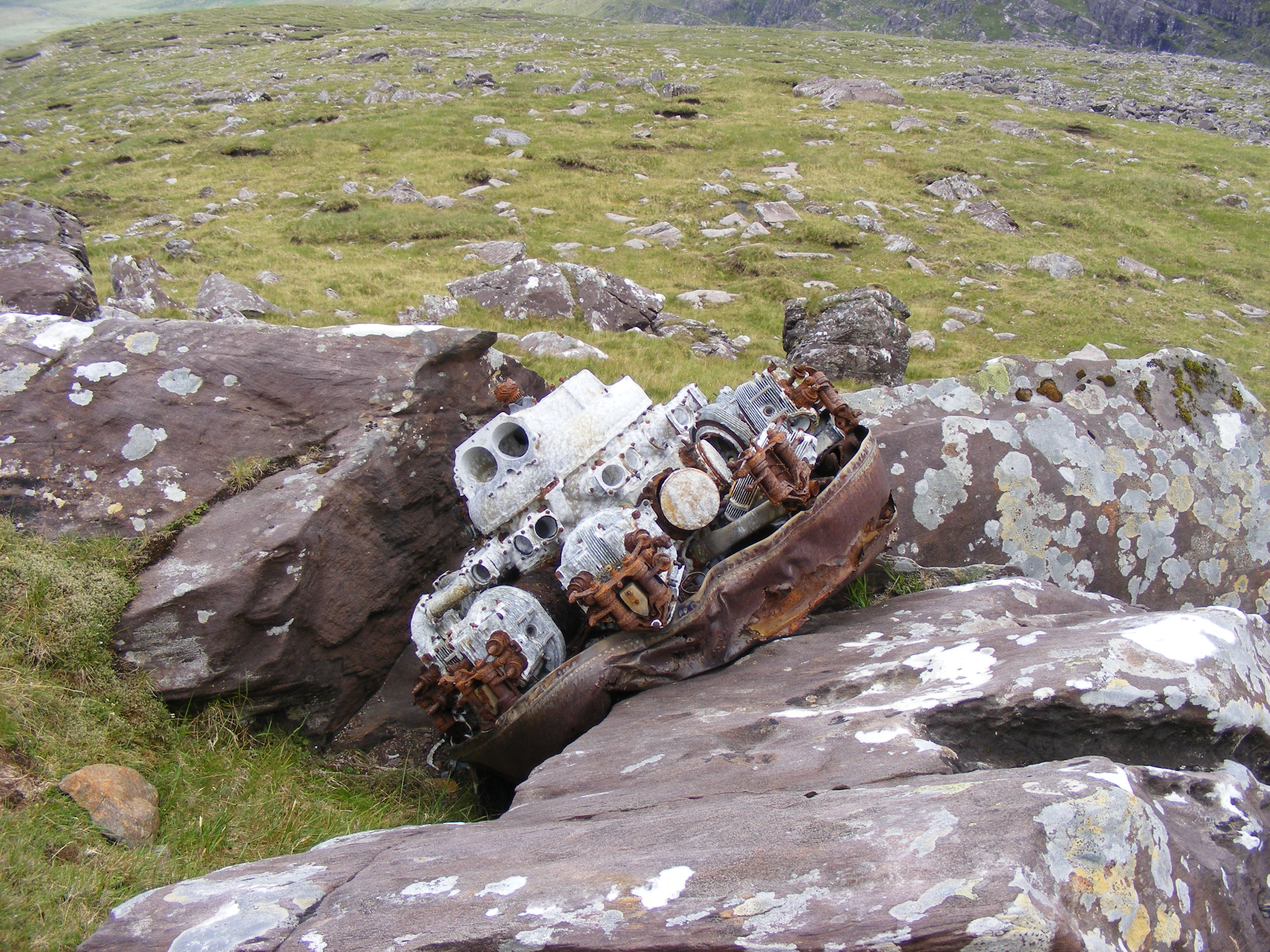 Another of G-AGES engines with front mounted               exhaust ring, lying as it fell on a rock.