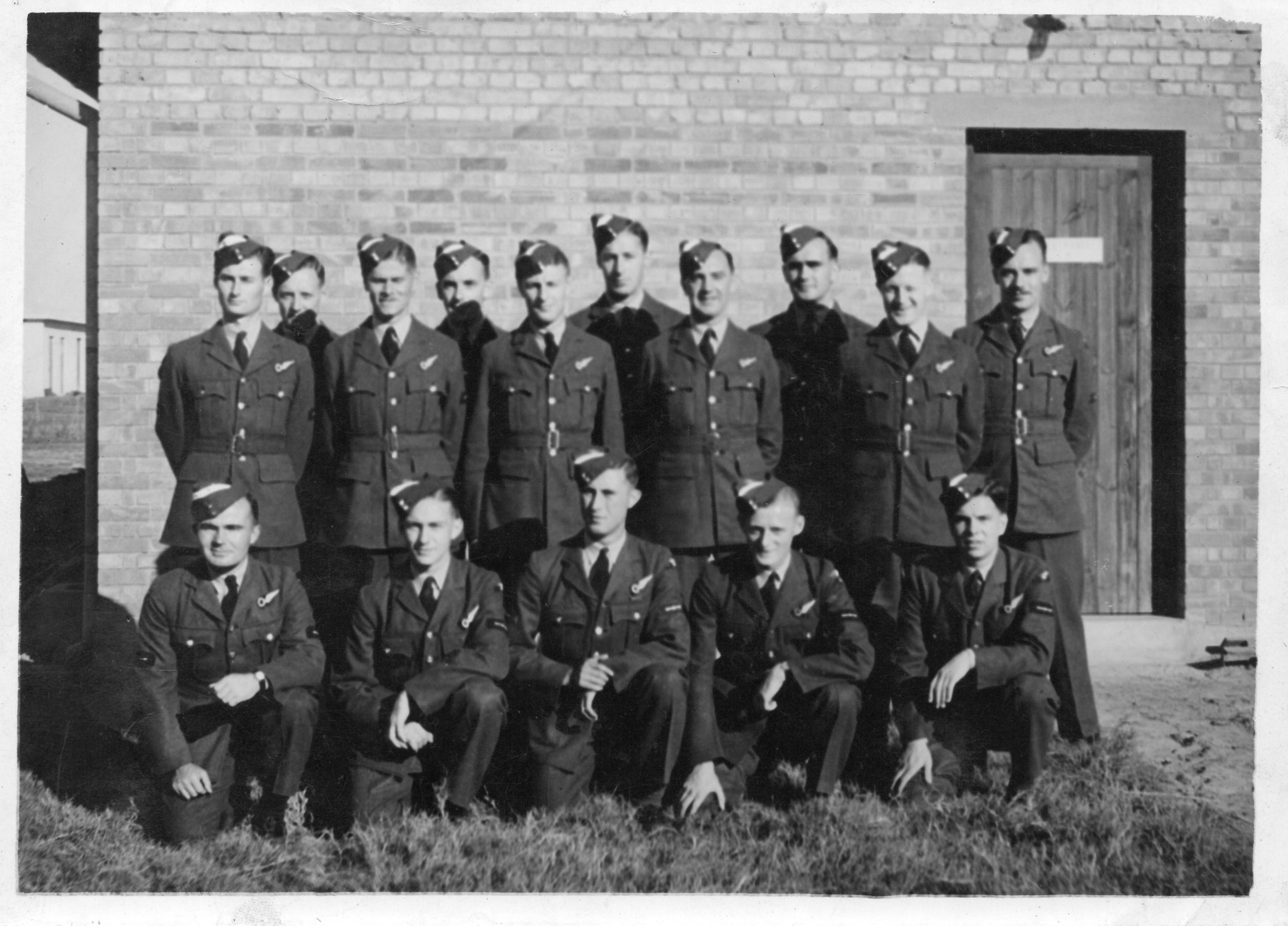 Group of 15 airmen, J C McGhee, front, 2nd from left