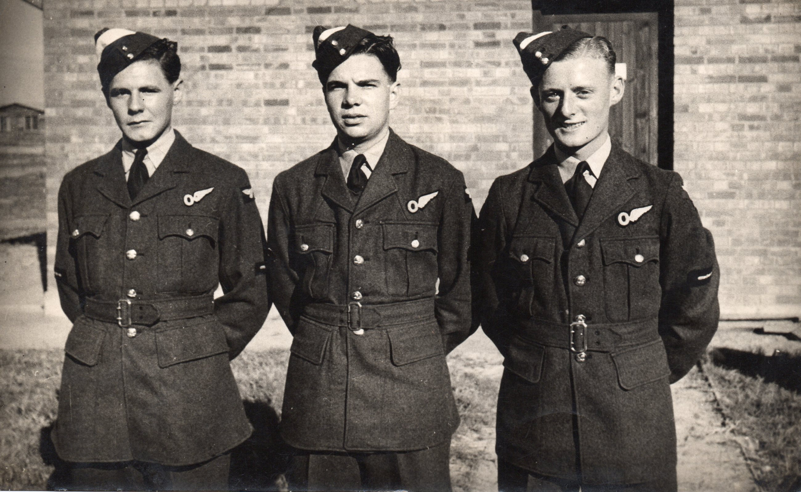 Groups of 3 airmen, J C McGhee at right